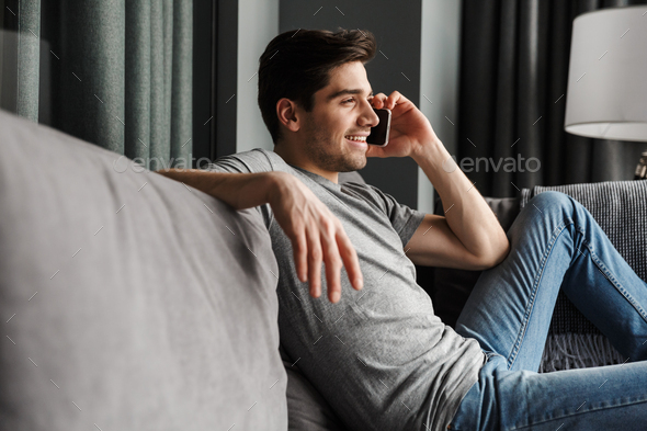 Portrait of an attractive young bearded man - Stock Photo - Images