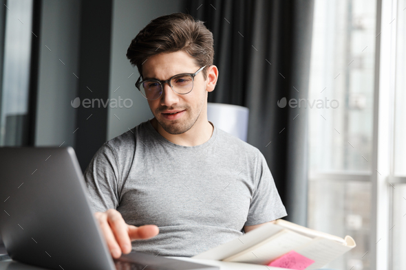 Handsome young bearded man wearing casual clothes - Stock Photo - Images