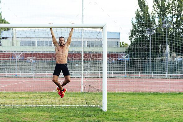 Man Doing Chin-ups outdoor. - Stock Photo - Images