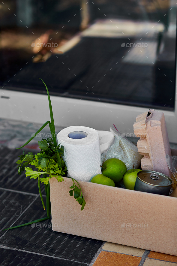 Delivery during the quarantine. Box with Merchandise, goods and food at door of home - Stock Photo - Images