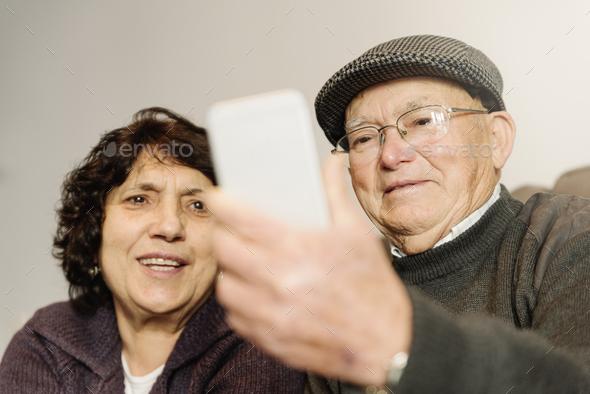 Senior rmarriage using his mobile phone. - Stock Photo - Images