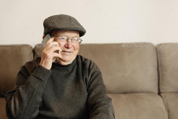 Senior man using his mobile phone. - Stock Photo - Images