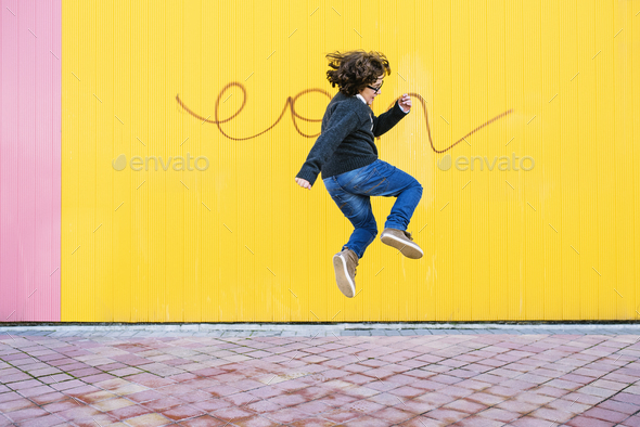 Happy boy jumping. - Stock Photo - Images