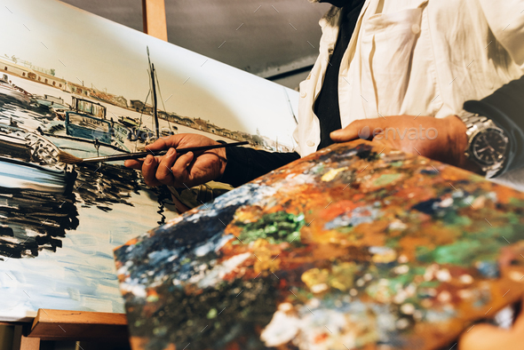 Close up of man artist painting oils in his studio. - Stock Photo - Images