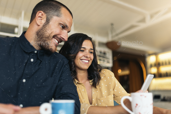 Happy friends using mobile. - Stock Photo - Images
