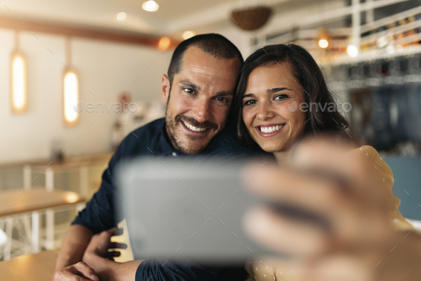 Happy couple taking selfie. - Stock Photo - Images