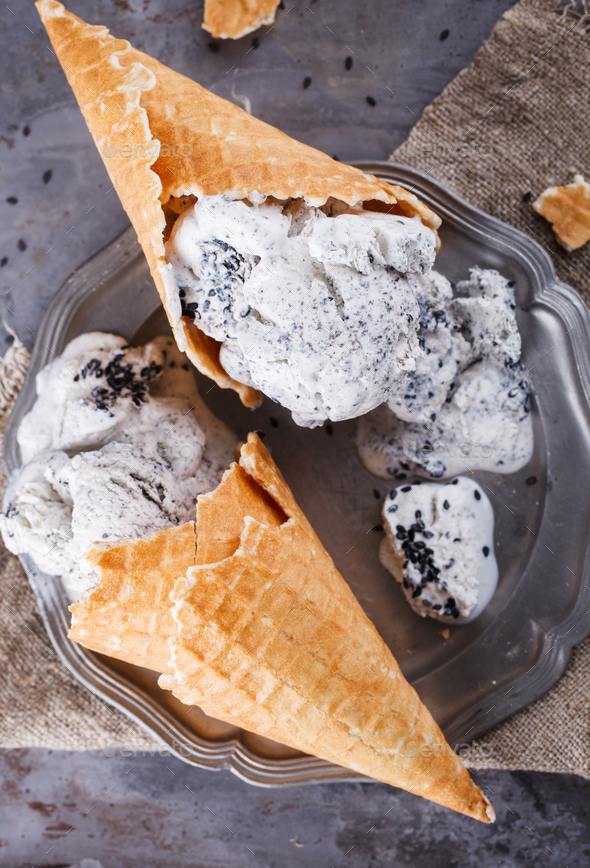 Ice cream with black sesame seeds in cones. - Stock Photo - Images