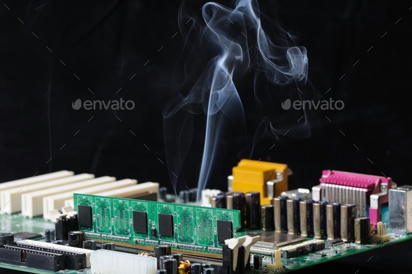 Thin stream of smoke is emitted from microcircuit - Stock Photo - Images