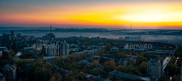 Aerial view fog over a provincial European city - Stock Photo - Images