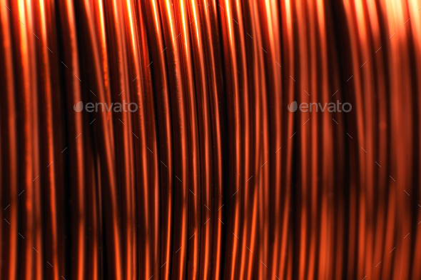 Close-up of a large coil of copper wire - Stock Photo - Images