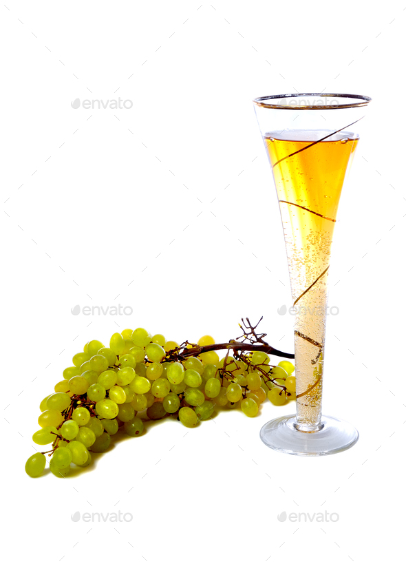 Wineglass with white wine and grape over white - Stock Photo - Images