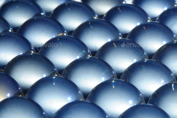 Close-up large glass balls lie next to each other - Stock Photo - Images