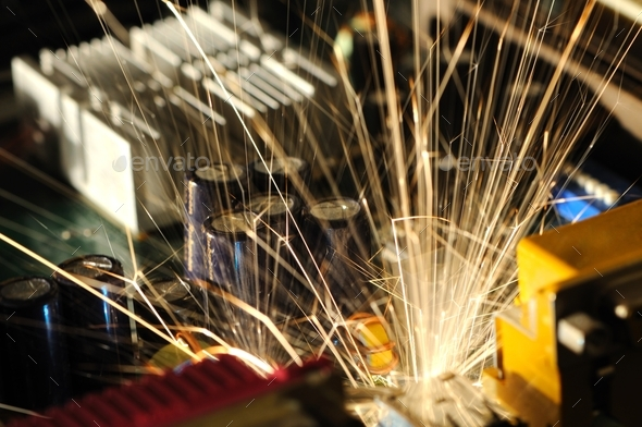 Burning sparks fly from a circuit chip - Stock Photo - Images
