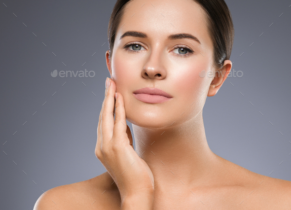 Beauty skin woman face healthy skin beautiful model close up face natural makeup brunette hair over - Stock Photo - Images