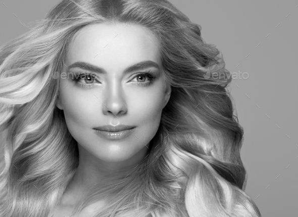Blonde face woman curly hair beauty face natural makeup. Monochrome gray black and white. - Stock Photo - Images