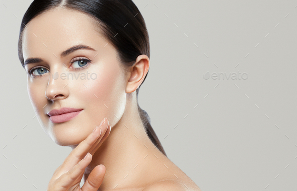 With hands young face woman close up healthy skin natural makeup gray background. - Stock Photo - Images