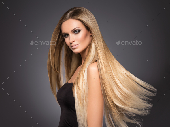 Hair beautiful long blond hairstyle woman fashion makeup healthy skin and hair black background - Stock Photo - Images