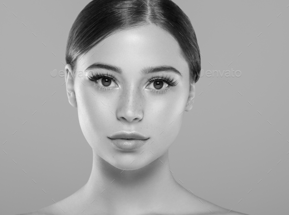 Eyes lashes woman face close up natural make up healthy skin. Monochrome. Gray. Black and white. - Stock Photo - Images