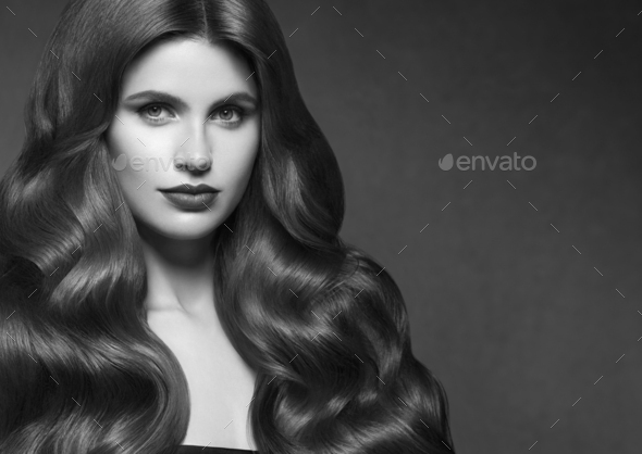 Hairte hairstyle model beauty woman long curly brunette. - Stock Photo - Images