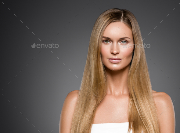 Beauty woman face healthy beautiful skin and blond smooth hair - Stock Photo - Images