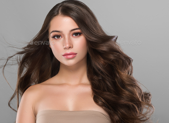 Beautiful brunette long curly hair woman with beauty makeup and healthy skin female fashion portrait - Stock Photo - Images