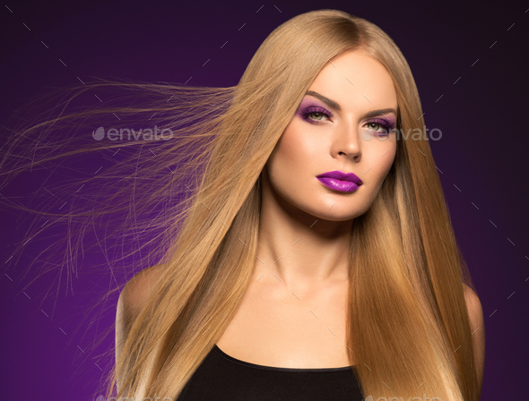Beautiful blonde woman hairstyle long smooth curly hair fashion makeup - Stock Photo - Images