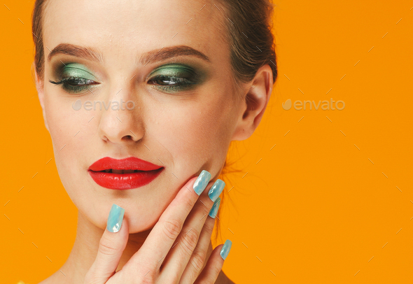 Color makeup woman happy yellow beauty background face female model - Stock Photo - Images