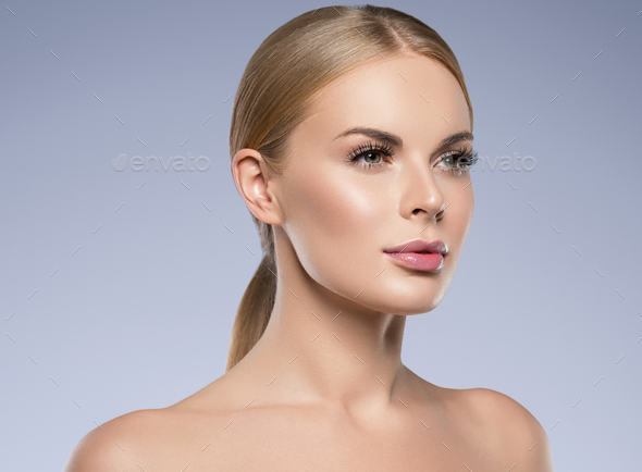 Beautiful woman blond with long hair natural makeup and healthy skin cosmetic concept - Stock Photo - Images