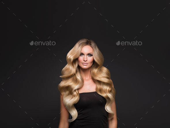 Blond woman long hair curly natural fashion makeup - Stock Photo - Images