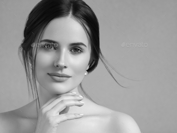 Beautiful woman portrait beauty hair and skin makeup young model. Monochrome. Gray. Black and white. - Stock Photo - Images