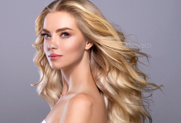 Blonde face woman curly hair beauty face natural makeup - Stock Photo - Images