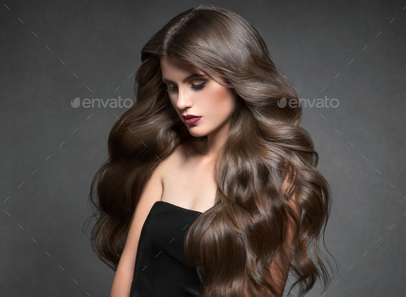 Hairte hairstyle model beauty woman long curly brunat - Stock Photo - Images