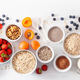 fruits for breakfast. Oatmeal flakes and steel cut, barley, walnut, chia, apricot, strawberry - PhotoDune Item for Sale