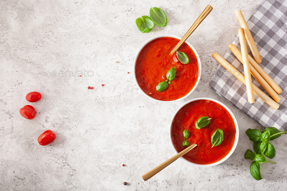 tomato and bell pepper vegetarian soup on green background - Stock Photo - Images