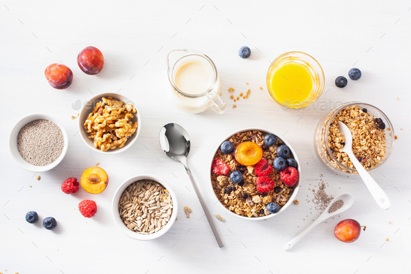 healthy granola for breakfast with berry fruit nut, vegan milk - Stock Photo - Images