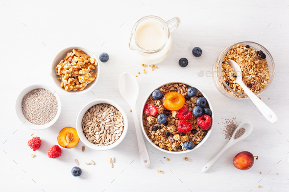 healthy granola for breakfast with berry fruit nut, plant milk - Stock Photo - Images