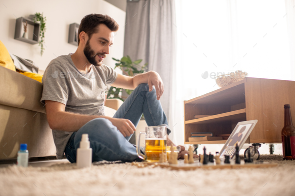 Playing chess with friend remotely - Stock Photo - Images