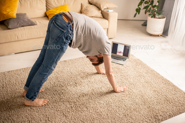 Practicing yoga with trainer online - Stock Photo - Images