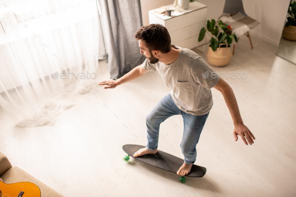 Balance training on skateboard at home - Stock Photo - Images