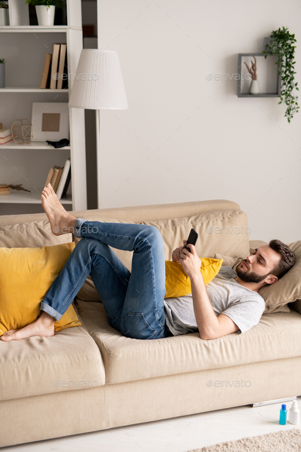 Using smartphone in home isolation - Stock Photo - Images