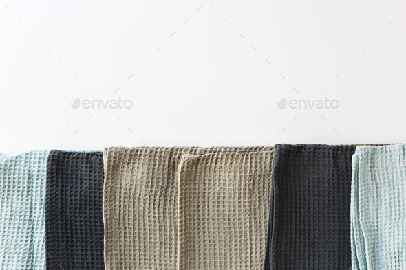 Stack kitchen cotton towels on white background - Stock Photo - Images