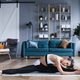 Beautiful young woman doing stretching exercises at the home. - PhotoDune Item for Sale