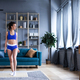 Beautiful woman woman in blue sportswear at home. - PhotoDune Item for Sale
