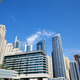 Dubai Marina skyscrapers low angle view in a sunny day, clear blue sky in Dubai - PhotoDune Item for Sale