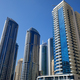 Dubai Marina skyscrapers in a sunny day, clear blue sky in Dubai - PhotoDune Item for Sale