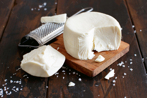 South Italian cheese cacioricotta with a grater - Stock Photo - Images