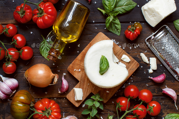 South Italian cheese cacioricotta with vegetables, herbs and olive oil - Stock Photo - Images