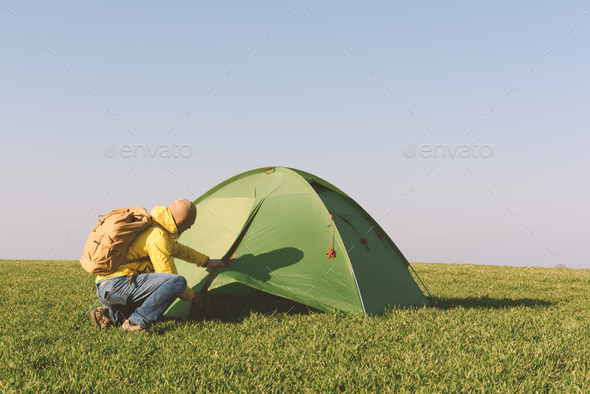 Tourist near his tent - Stock Photo - Images