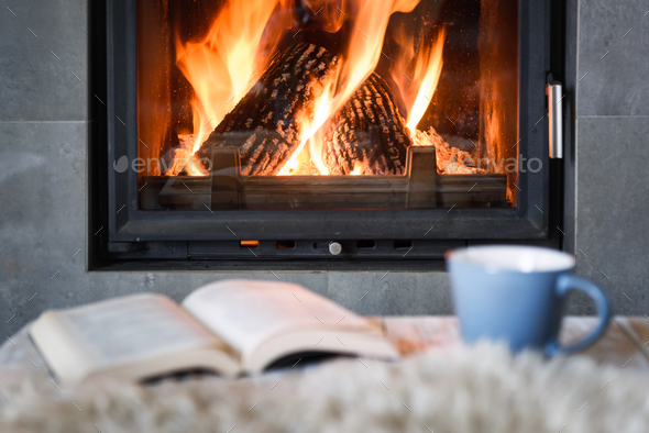 Hygge concept with book and tea - Stock Photo - Images