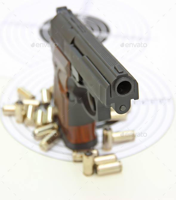 The Pistol With The Brown Handle - Stock Photo - Images